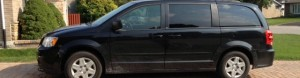 black mini van parked in my driveway