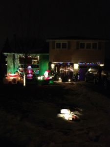 Christmas 2014.   Not one, not two, but three inflatables on our lawn, a random assortment of coloured and white lights and of course a mini van in the driveway.